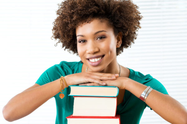 woman with hardcover books - deposit photos